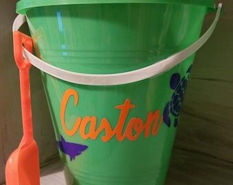 Sand Bucket with shovel.