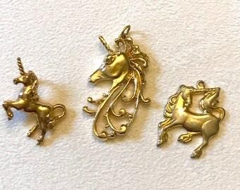 Three Vintage Unicorn Gold Tone Pendants