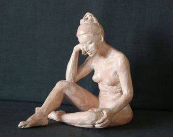 Weathered terracotta nude woman sculpture