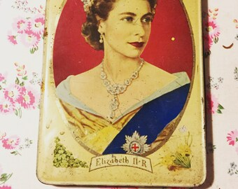 Vintage Queen large tin.