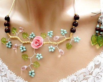 Pink and green floral ornament