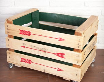 Fruit box restored and painted green on the inside with red arrows.