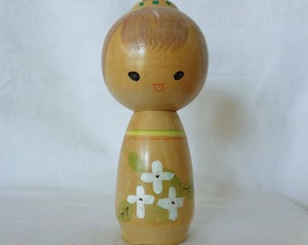 1047: Kokeshi doll, Vintage Japanese wooden Sosaku Kokeshi doll with floral pattern, signed,Handcrafted in Japan