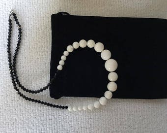 Fishbone pearls and black crystals