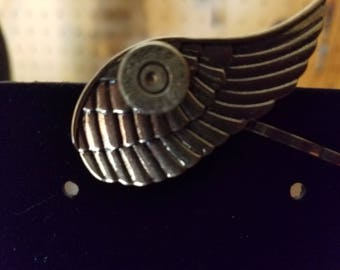 Winged hair pin with 38 recycled casing