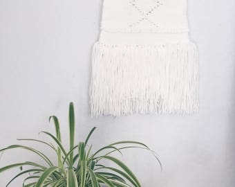 White simple wall hanging