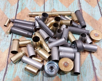 Mixed lot, 50 pieces of bullet shell casings. Includes steel, aluminum and brass casings. A great variety  (lot#17)