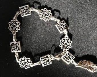 Silver Vintage Look 8 inch Bracelet with Dangling Leaf at Closure