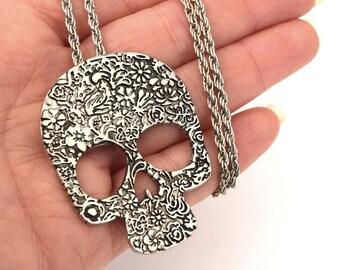 Silver skull pendant antique flower motifs