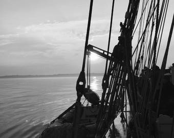 black and white ship/boat at sunset photography print
