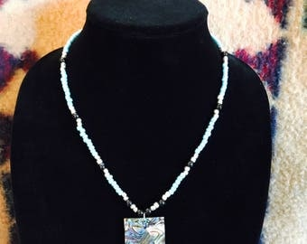 beaded necklace, glass and plastic pendant with mother of pearl accent