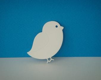 Cut little bird in white canson paper