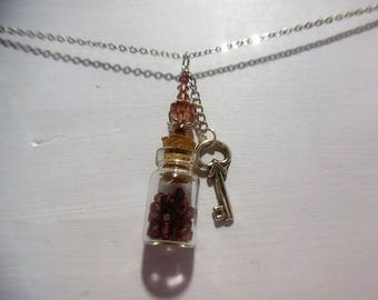 Necklace vial and pearls