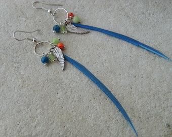 Pendants and beads and blue feather earrings