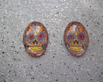 Lot de 2 cabochons images tête de mort, skull