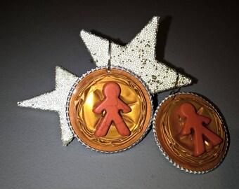 Orange earrings made of Nespresso capsules based