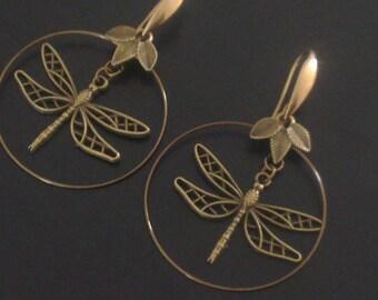 Pair of dragonflies on hoop earrings - bronze colored foliage