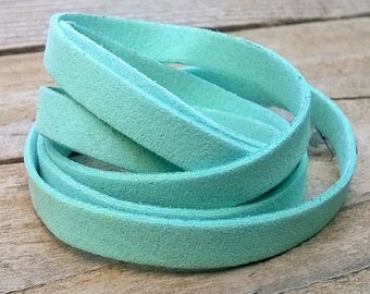 7mm. 98cm (approx.) 7mm turquoise colored suede cord string