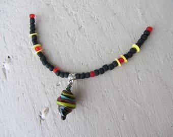 pendant necklace charm of Lampwork Glass black, yellow, red, turquoise swirl with large seed beads on wire nylon adjustable collar