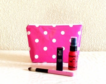 Hot pink cosmetic case in oilcloth
