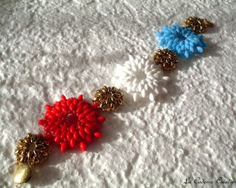 beaded blue, white, red and gold - gold clasp bracelet