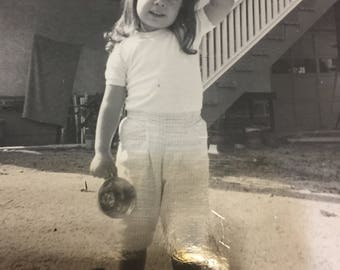 This is me at about 5 or 6 years old being fascinated with Greek/Turkish Coffee cup readings.