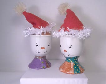 Christmas snowmen, snow cups and their hats