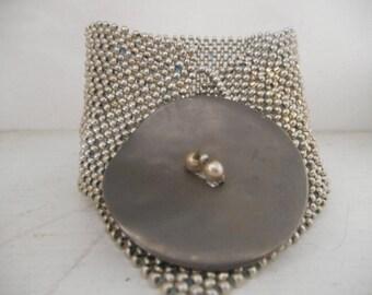 bracelet tissé en pièce unique couture.