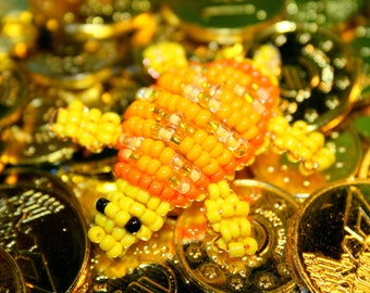 Animal beads: yellow and orange turtle beads