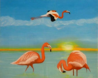 The flamingos in the Camargue in flight at St. streams