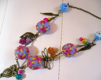 necklace made of wool felt and embroidered beads, pink blue and yellow