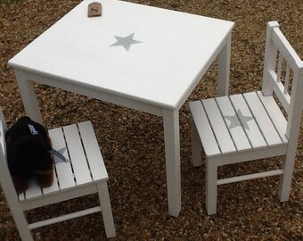 ENSMBLE TABLE AND 2 ANTIQUE WHITE WITH BLUE GREY STAR CHILDREN'S CHAIRS