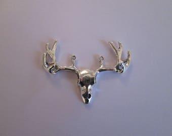 1 pendentif cerf  53 x 37 mm en métal argenté