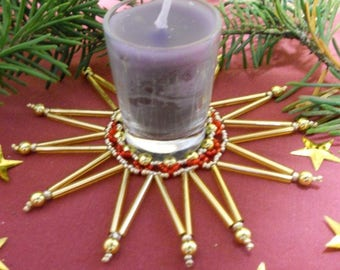 Gold/red beads and Christmas table candles