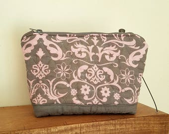 Small toiletry bag in pink and gray quilted fabric