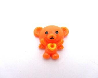 1 small Teddy bear resin orange