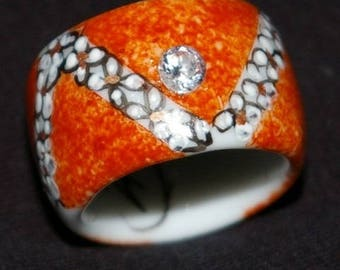 Jewel ring porcelain hand painted with a rhinestone in the middle.