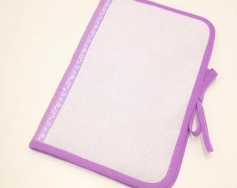 Health book has cross-stitch on 2 sides, purple fabric.