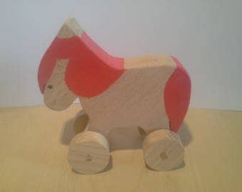 Wooden Toy: Pink Pony on wheels in beech wood