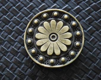 Engraved decorative round coin, antique bronze.