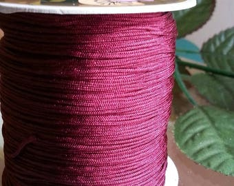 large Burgundy coil Fils à coudre nylon, 0.8 mm, approximately 120 m / bibone