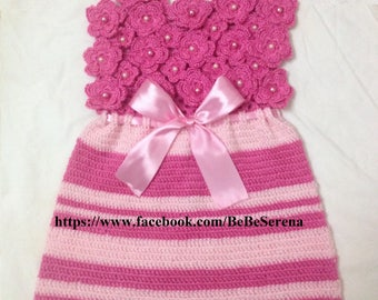 Pretty pink flowers of spring crochet baby dress