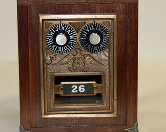 Bank Made using an original Post Office Box Door