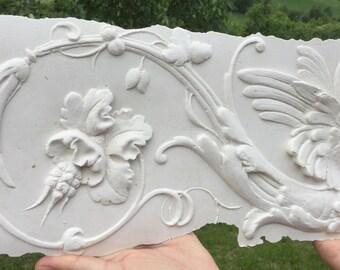 """Dragon"" plaster bas-relief decoration."