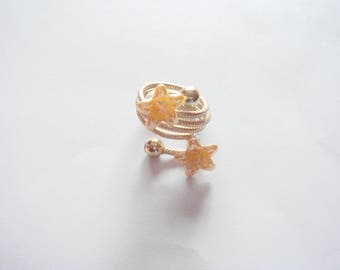 small flowers on gold aluminum wire ring