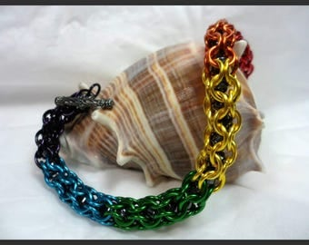 Rainbow themed inverted round captured crystal bracelet