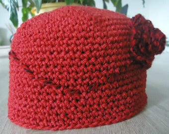 12 months with its pretty red flower Hat