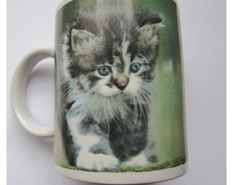 Mug showing a kitten