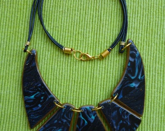 Polymer clay and leather necklace bib.