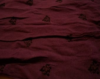 Synthetic purple patterned fabric coupon